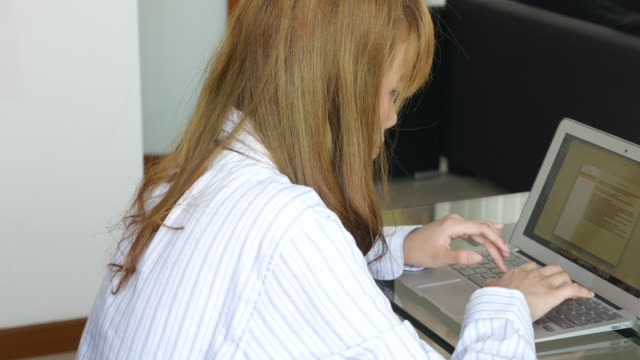 young woman using laptop - log on stock videos & royalty-free footage