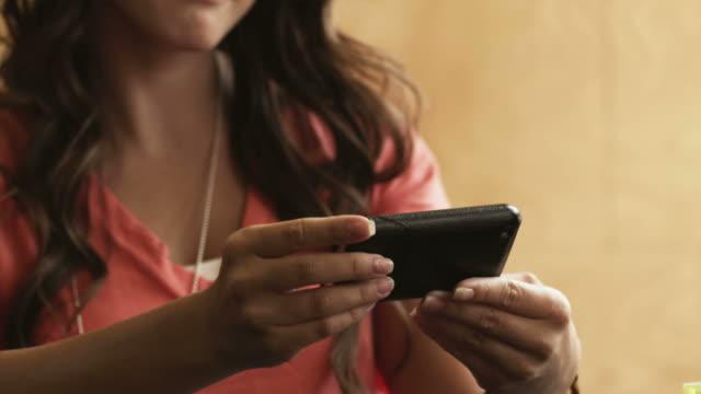 cu tu young woman using mobile phone, provo, utah, usa - provo stock videos & royalty-free footage
