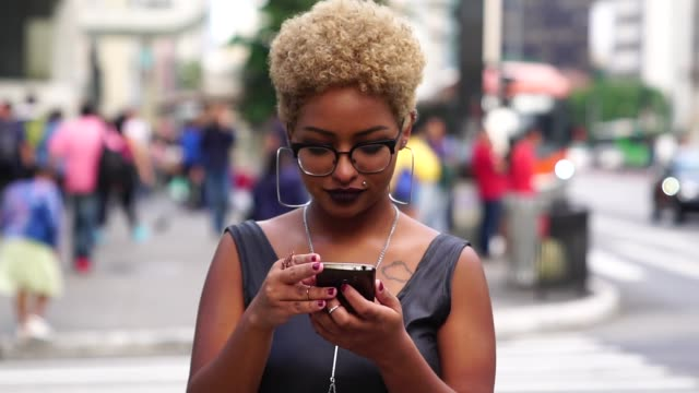 young woman using mobile - sidewalk stock videos & royalty-free footage