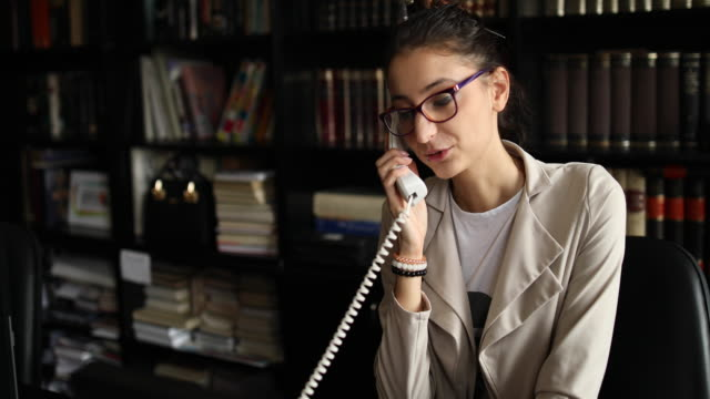 young woman using retro phone at the office - lip ring stock videos and b-roll footage