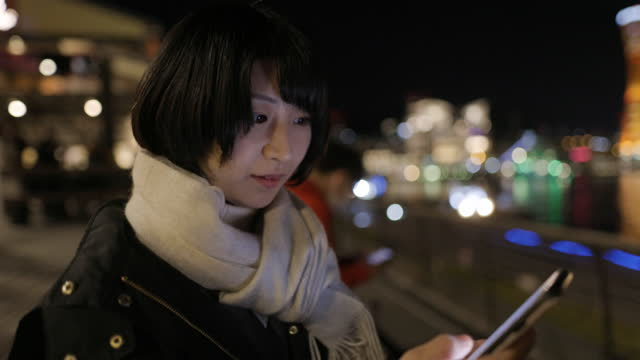 young woman using smart phone at night - scarf stock videos & royalty-free footage