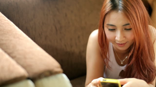 young woman using smart phone - 1910 stock videos & royalty-free footage