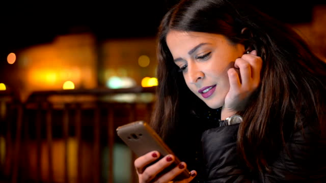 young woman using smart phone - young women stock videos & royalty-free footage