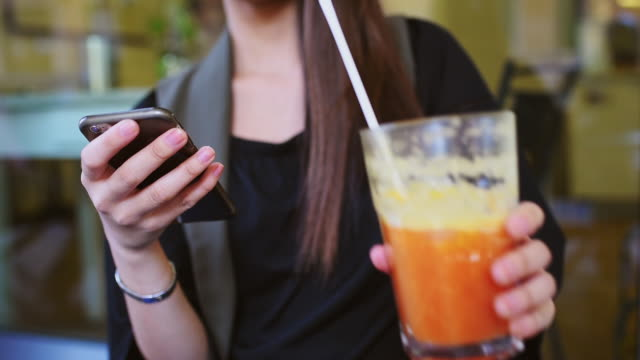 young woman using smart phone - straw stock videos & royalty-free footage