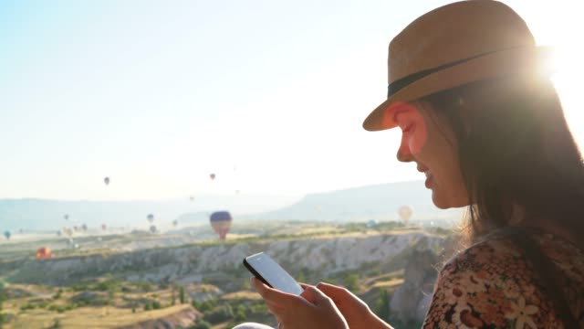 young woman using smartphone in cappadocia, turkey - one young woman only stock videos & royalty-free footage