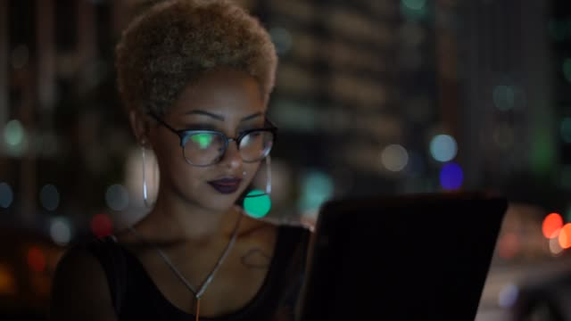 young woman using tablet at night - alternative lifestyle stock videos & royalty-free footage