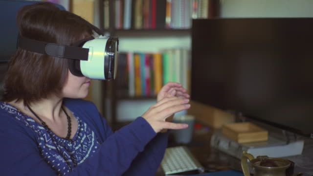 young woman using vr glass - silvestre stock-videos und b-roll-filmmaterial