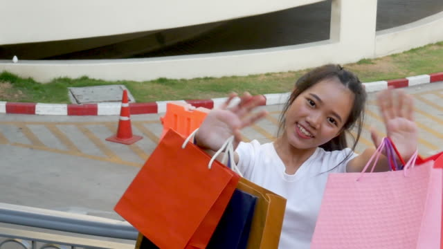 young woman very cheerful with shopping bags