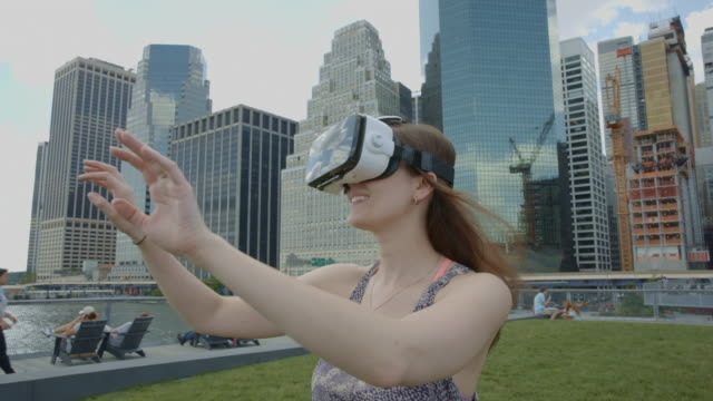 Young woman virtual reality googles headset downtown Manhattan NYC