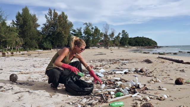 young woman volunteer cleaning plastic pollution from beach - krabi province stock videos & royalty-free footage