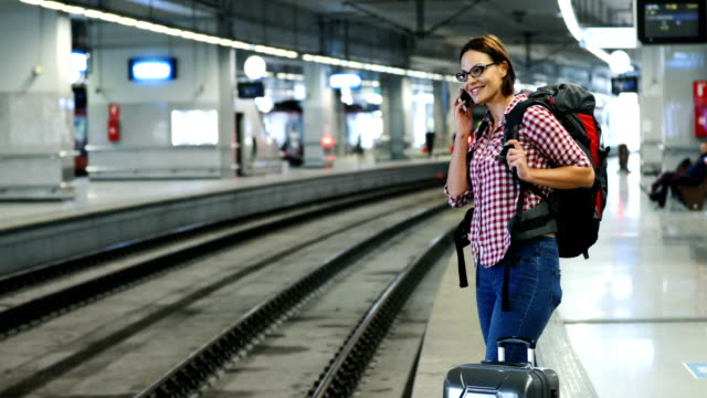 young woman waiting for a train. - railway station platform stock videos & royalty-free footage