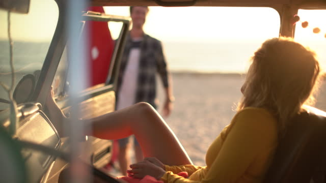 ms young woman waiting for her boyfriend in a car - wohnmobil stock-videos und b-roll-filmmaterial