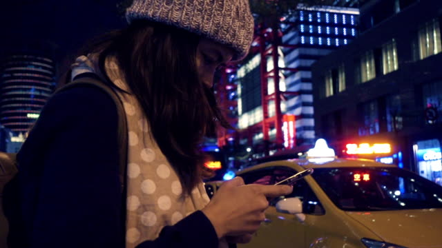 young woman waiting for taxi or uber. - crowdsourced taxi stock videos and b-roll footage