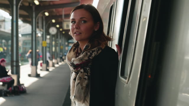 young woman waiting for the train - commuter stock videos & royalty-free footage