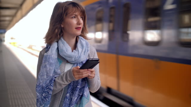 young woman waiting for train - characters stock videos & royalty-free footage