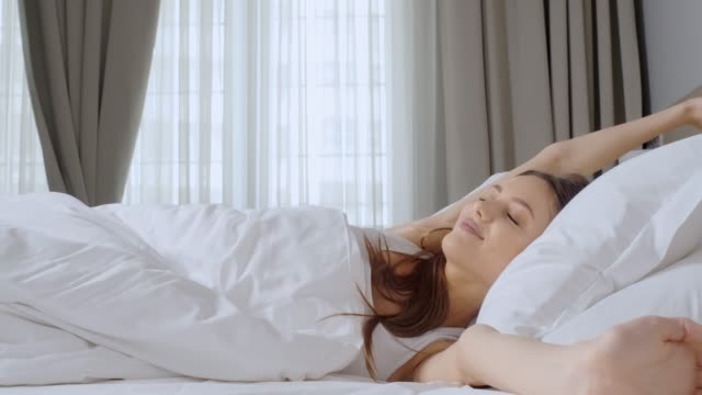 young woman waking up. - sleeping stock videos & royalty-free footage