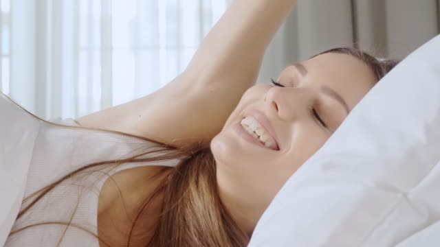 young woman waking up. - riposarsi video stock e b–roll