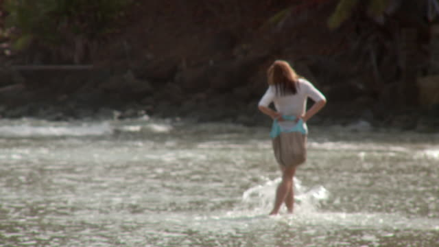 focus ws rv young woman walking along surf with beach bag/ scarborough, tobago, trinidad and tobago - beach bag stock videos and b-roll footage