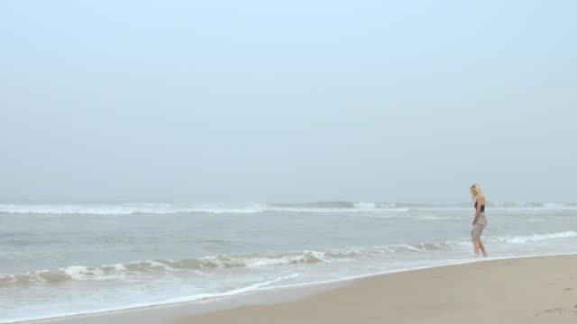 young woman walking along the pacific coastline in malibu 4k - vesper stock stock videos & royalty-free footage