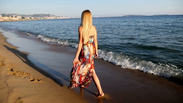 young woman walking along the sea - naked stock videos & royalty-free footage