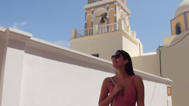 young woman walking and exploring her vacation in greek island - mykonos stock videos & royalty-free footage