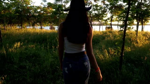 Young Woman Walking At Nature