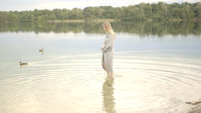young woman walking in water. - walking in water stock videos & royalty-free footage