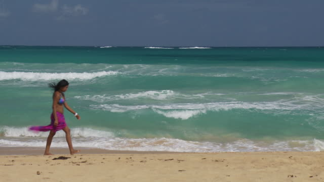 WS, Young woman walking on beach, Punta Cana, Dominican Republic