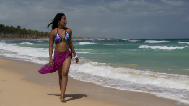 ws, cu, young woman walking on beach, punta cana, dominican republic - punta cana stock videos and b-roll footage