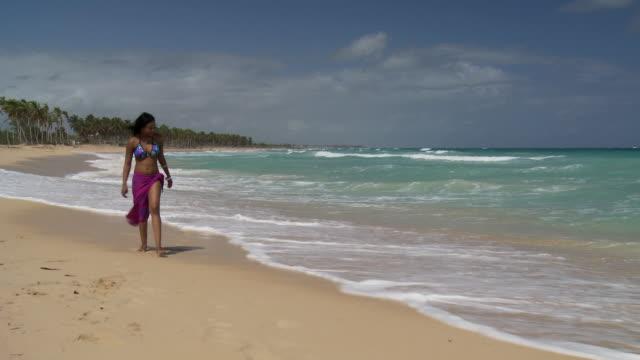 WS, CU, Young woman walking on beach, Punta Cana, Dominican Republic