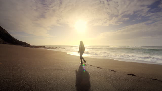 young woman walking on pacific beach at sunset, oregon - barefoot stock videos & royalty-free footage