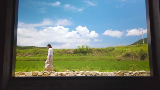 young woman walking on path - endast unga kvinnor bildbanksvideor och videomaterial från bakom kulisserna