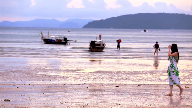 hd: young woman walking on the beach at sunset (video) - railay beach stock videos and b-roll footage