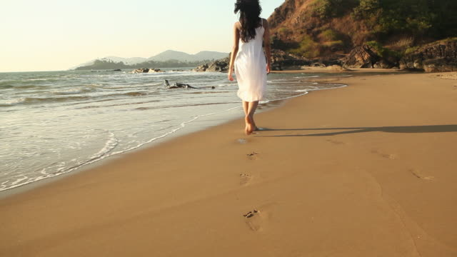 young woman walking on the beach  - sand stock videos & royalty-free footage