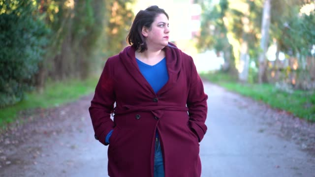 young woman walking on the street - overweight stock videos & royalty-free footage