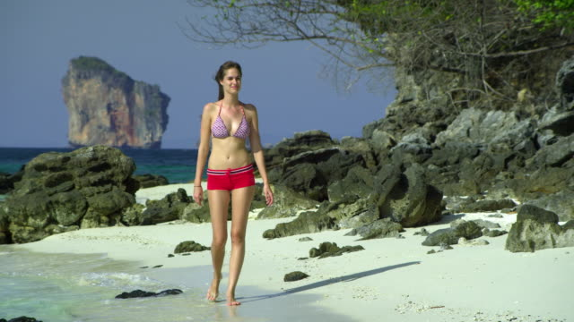ms young woman walking on tropical beach, krabi, thailand - see other clips from this shoot 1459 stock videos and b-roll footage