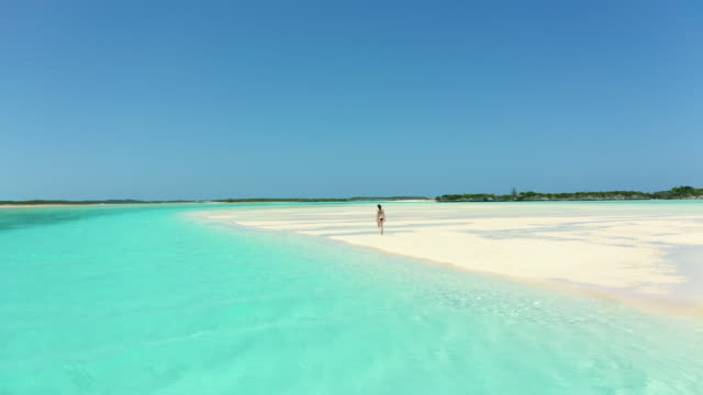 young woman walking on tropical beach - turquoise colored stock videos & royalty-free footage