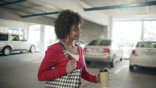 ms young woman walking through a parking garage - handbag stock videos & royalty-free footage