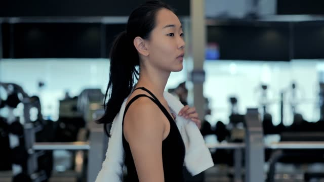 young woman walking to gym.woman working out in the gym.sport prep - health club stock videos & royalty-free footage