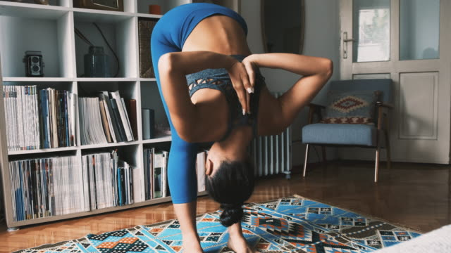 young woman warm-up for yoga workout at home - mudra stock videos & royalty-free footage