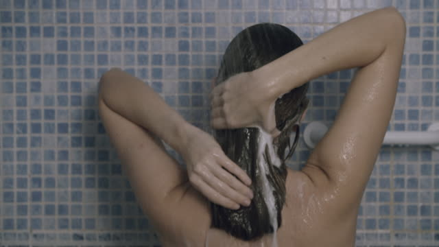 young woman washing her hair - wet hair stock videos and b-roll footage