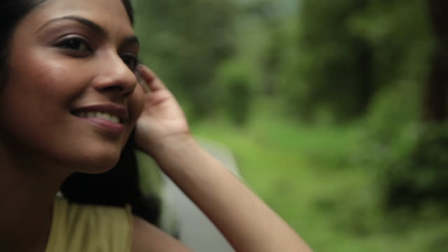 young woman watching from window of a car, malshej ghat, maharashtra, india - arm stock videos & royalty-free footage