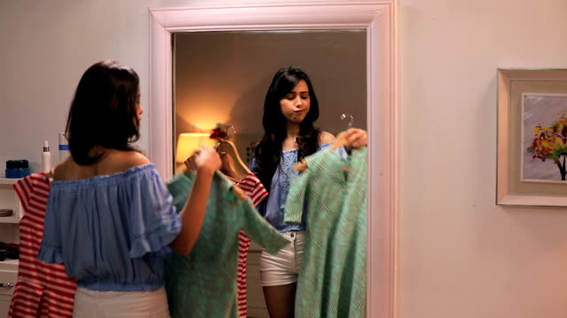 young woman watching her dresses in the mirror, delhi, india - specchio video stock e b–roll