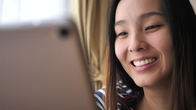Young woman watching on screen on Digital tablet
