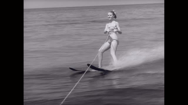 ws ts young woman waterskiing / united states - ウェイクボーディング点の映像素材/bロール