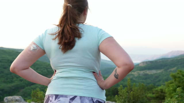 young woman wearing a cgm and admiring the view during workout - type 1 diabetes stock videos & royalty-free footage