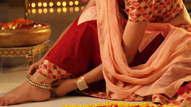 ms td young woman wearing anklet during diwali festival / new delhi, delhi, india - fußkettchen stock-videos und b-roll-filmmaterial