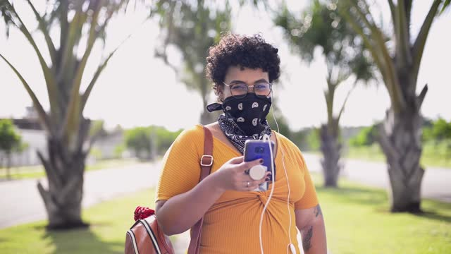 young woman wearing bandana as protective face mask - pardo brazilian stock videos & royalty-free footage