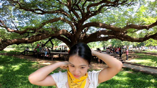 young woman wearing bandana protective face mask while travel in the park - neck stock videos & royalty-free footage
