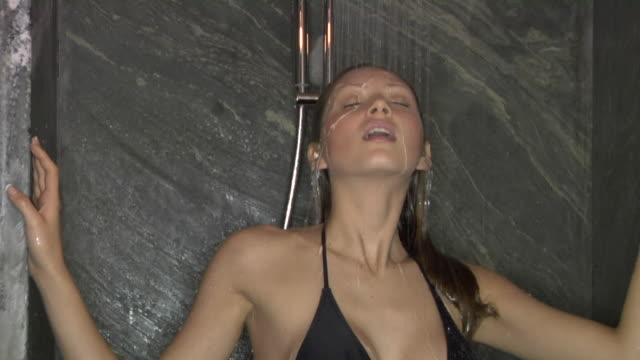 cu, zi, young woman wearing bikini taking shower - wet hair stock videos & royalty-free footage